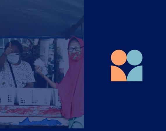 Two women at community market